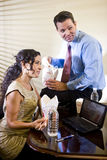 Co-workers in office eating Chinese takeout food Royalty Free Stock Photos
