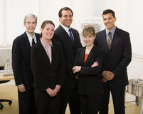 Co-workers posing in office Royalty Free Stock Photo