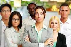 Co-workers standing in office Stock Image