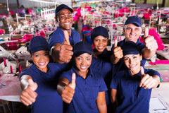 Co-workers thumbs up Royalty Free Stock Images