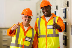 Co-workers thumbs up Stock Photos