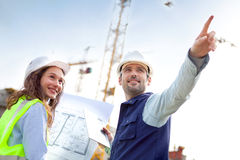Co-workers working on a construction site Royalty Free Stock Image