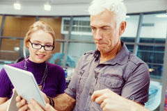 Co-workers working together Stock Images