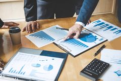 Co working conference, Business team colleagues discussing working analysis with financial data and marketing growth report graph. In team, Business finances royalty free stock photo
