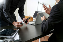 Co working meeting,two businessman using VOIP headset with latop computer on desk in modern office as call center and customer se. Rvice help desk concept royalty free stock image