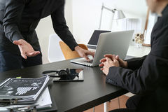 Co working meeting,two businessman using VOIP headset with latop computer on desk in modern office as call center and customer se. Rvice help desk concept stock photos
