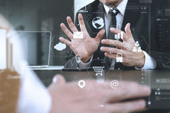 Co working team meeting concept,businessman using smart phone an. D digital tablet and laptop computer in modern office with virtual graph chart and icon diagram Royalty Free Stock Images