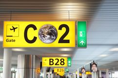 CO2 aviation concept. Airport terminal departure gate interior with head sign reminding of the carbon footstep of travel and flying and CO2 impact on climate Stock Photo