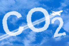 CO2 Environmental impact. Image of an aeroplane against an cloudy image of co2 Stock Photography