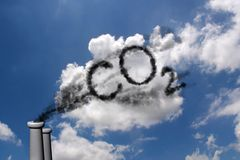 CO2 pollution. CO2 written in smoke in a cloudy sky Stock Photo