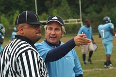 Coach argues with referee stock photography