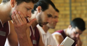Coach and basketball players using digital tablet stock video footage