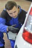 Coach-builder checking the car Stock Photos