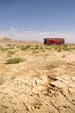 Coach bus in desert. Coach bus cruising across the desert in Syria Stock Images