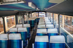 Coach bus interior. Interior of empty coach bus with blue seats Stock Photos