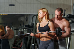 Coach client in gym Stock Images
