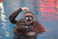 Coach diving in water Stock Images