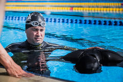 Coach Doing the Safety and Watching the Performer doing Static A. Montreal, CANADA - May 30th, 2015. Official AIDA Freediving Pool Competition Taking place in Royalty Free Stock Images