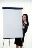 Coach before empty. Young coach before empty flipchart on education and training Royalty Free Stock Photos