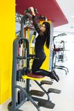 Sportswoman train with coaches help in gym. The coach is engaged with a woman in the gym. The concept of a healthy lifestyle royalty free stock photos