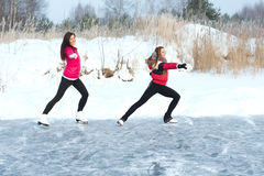 Coach of figure skating with apprentice practise at the frozen lake Stock Image