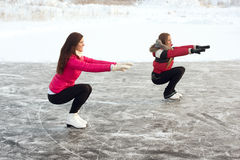 Coach of figure skating with apprentice practise at the frozen lake Stock Photos
