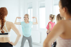 Coach during fitness training Royalty Free Stock Photo