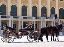 Coach in front of castle schoenbrunn, Vienna. Attraction for tourists to Austria Royalty Free Stock Photo