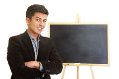 Coach in front of chalkboard Royalty Free Stock Photography