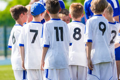 Coach giving young soccer team instructions. Youth soccer team t. Ogether before final game. Football match for children. Boys group shout team, gathering. Coach Royalty Free Stock Photography