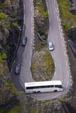 Coach in hairpin curve. Coach having trouble with turning in sharp hairpin on Trollstigen Pass in Norway stock photo
