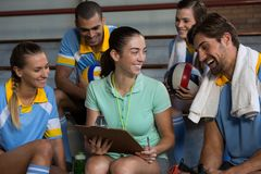 Coach with happy volleyball players Stock Images