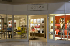 Coach fashion store. Coach has a very clean and elegant style. It is luxury but not exaggerated. It is shiny but humble. It is simple but eyes catching. The Royalty Free Stock Image