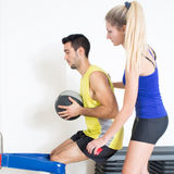 Coach helping with medicine ball training Royalty Free Stock Photo