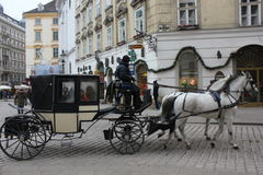 A coach with horse in Vienna city centre. VIENNA, AUSTRIA - JANUARY 3 2016: A coach with horse in Vienna city centre at day time Royalty Free Stock Photos