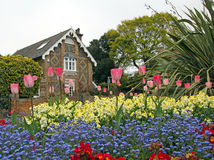 The coach house and flower display Royalty Free Stock Photos
