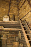 Coach-house interior. Ancient rural coach-house interior with wooden cart Royalty Free Stock Images