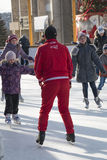 Coach at the ice rink teaches kids to skate Royalty Free Stock Photo