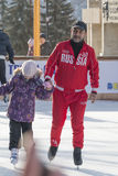 Coach at the ice rink teaches kids to skate Royalty Free Stock Photography