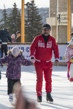Coach at the ice rink teaches kids to skate Stock Image
