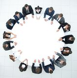 Coach leads the session with business team sitting at a round table. Royalty Free Stock Photos