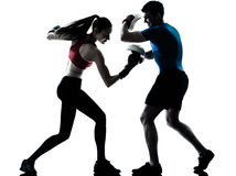 Coach man woman exercising boxe