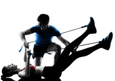 Coach Man Woman Exercising Gymstick Royalty Free Stock Photo