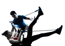 Coach man woman exercising gymstick Stock Image