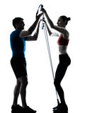 Coach man woman exercising gymstick Stock Images