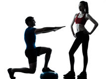 Coach man woman exercising squats on bosu Stock Image