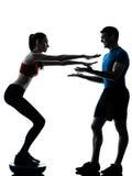 Coach man woman exercising squats on bosu royalty free stock images