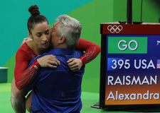 Coach Mihai Brestyan and Olympic champion Aly Raisman of USA during competition on balance beam at women`s all-around gymnastics. RIO DE JANEIRO, BRAZIL - AUGUST Stock Image