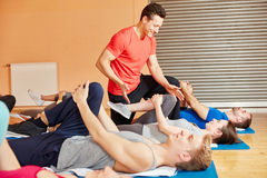 Coach motivating his pilates group. With healthy stretching Royalty Free Stock Images