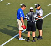Coach and Officials royalty free stock image